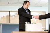 employee shakes hand of boss before leaving