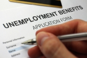 person filling out unemployment benefits form